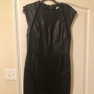 Black faux leather dress.